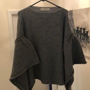 Gray poncho style sweater with beaded detail. Zara